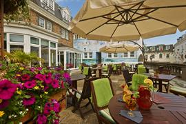 Outdoor dining area at Moores Central Hotel Guernsey